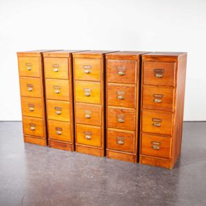 Five vintage wooden cabinets with metal handles on a white background