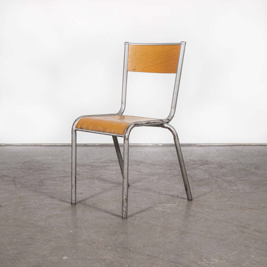 Vintage metal chair with wooden seat and backrest on a white background